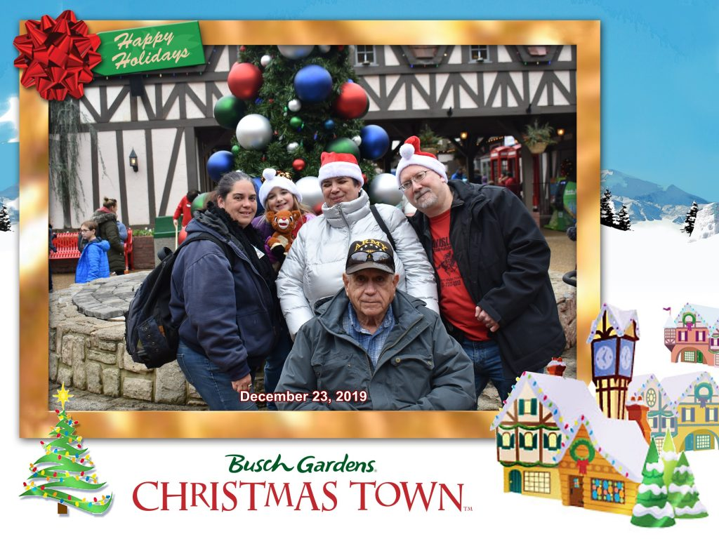 Bush Gardens, Christmas Town 2019  Adrianne Peddicord in the blue jacket, Kassie, I'm in the silver, and hubby is in the black coat, and dad is in the hat.